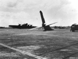 Wreckage of B-17C bomber beside Hangar 5 at Hickam Field after Japanese bombing on December 7, 1941.