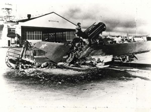Warhawk wreck in front of Hangar 4 at Wheeler Field, December 7, 1941. Several P-40s and P-36s got airborne during the attack and destroyed nine enemy aircraft in air-to-air combat.